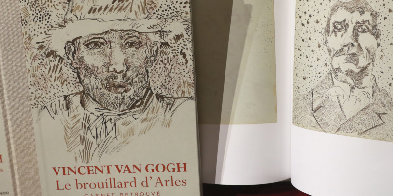 This picture taken on November 15, 2016, shows a book of drawings from Dutch post-impressionist painter Vincent Van Gogh displayed during a press conference at the architecture academy in Paris. / AFP PHOTO / JACQUES DEMARTHON