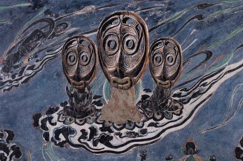 """Evolution-Apsaras from the North Wall of Mogao Cave No. 321, Iatmul Canoe Prow Mask / 進化-莫高窟321窟主室北壁飛天、Iatmul 獨木舟船頭面具""2016, Xu Zhen"