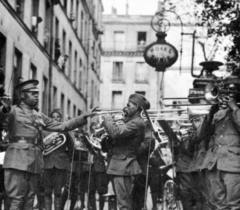 WORLD WAR I: BLACK BAND.  Lieutenant James Reese Europe conducting the 369th Regimental Band outside American Red Cross Hospital No. 9 in Paris, 1918. 0068957