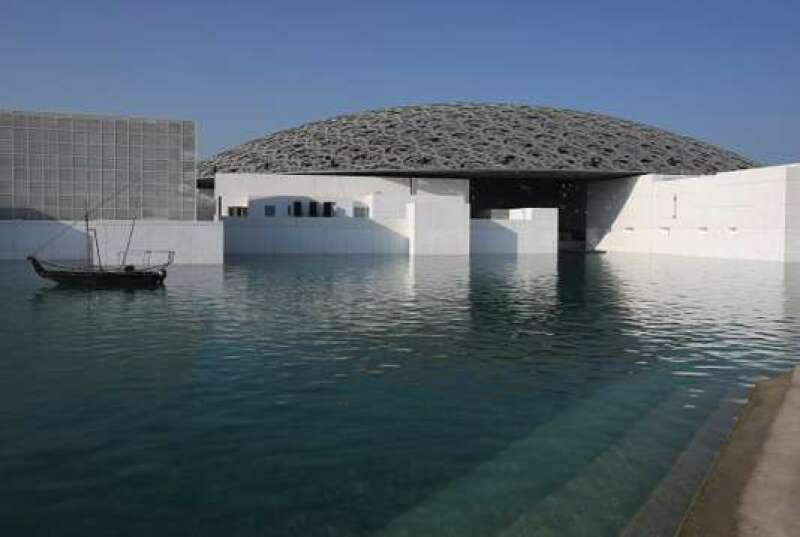 This Monday, Nov. 6, 2017, photo, shows the Louvre Abu Dhabi in Abu Dhabi, United Arab Emirates. The Louvre Abu Dhabi is preparing its grand opening, unveiling its treasures to the world after a decade-long wait and questions over laborers' rights. The museum, which opens on Saturday, Nov. 11 to the public, encompasses work from both the East and West. (AP Photo/Kamran Jebreili)