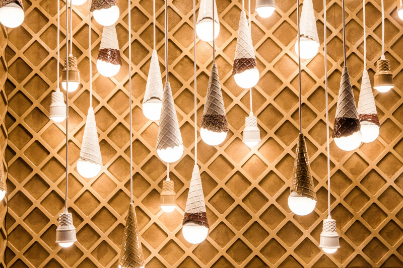 Dangling light fixtures created by artist Alex Garnett in a room dedicated to ice cream cones during a press preview of the Museum of Ice Cream in New York, July 28, 2016. The sold-out spectacle uses art installations mixed with taste experiments to tap into childlike memories of summer days and ice cream cones. (George Etheredge/The New York Times)