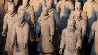 "(FILES) This file photo taken on January 8, 2018 shows China's famous terracotta warriors pictured in the northern Chinese city of Xian. The theft of a thumb off an ancient Terracotta Warrior statue on display in the US incited a wave of criticism on Chinese social media on February 20, 2018, following China's calls to ""severely punish"" the thief. / AFP PHOTO / POOL / LUDOVIC MARIN"