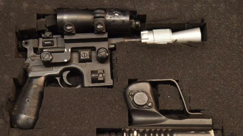 Star Wars' Han Solo's BlasTech DL-44 blaster (estimated value $300,000 - 500,000) is exhibited by Julien's Auctions at Planet Hollywood, in New York, on May 21, 2018.   The auction will take place on June 23, 2018, in Planet Hollywood Resort & Casino in Las Vegas. / AFP PHOTO / HECTOR RETAMAL