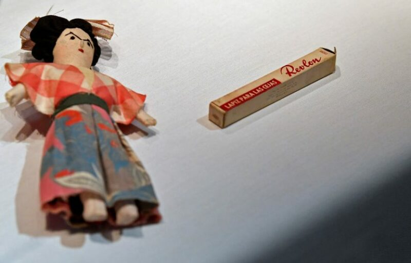 A hand-made doll and eyebrow pencil