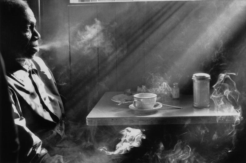 Harold Feinstein, Man Smoking in Diner, 1974