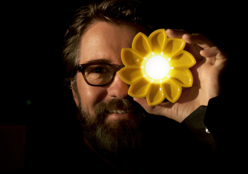 Olafur Eliasson with a Little Sun torch. Photo by Tomas Gislason Little Sun