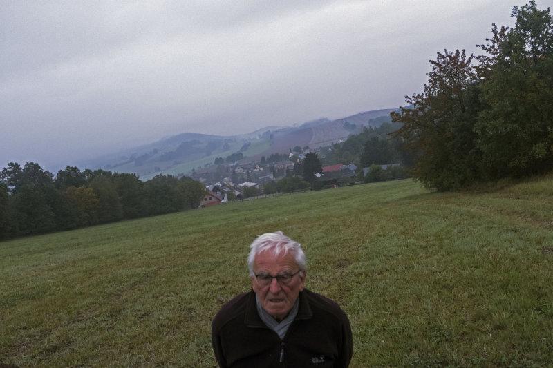 CZECH REPUBLIC, 2017/09. Moravia. Šumperk / Mährisch Schönberg. Village Hrabišin - Rabersdorf. My father walks the fields above the village where his family had a farm until 1946.