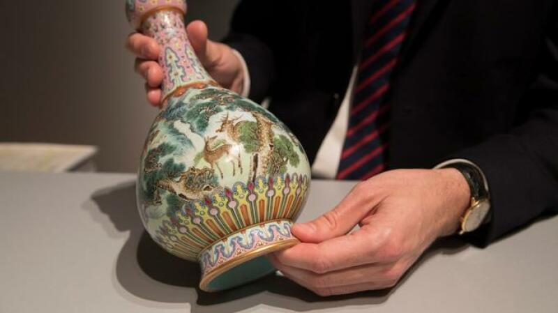 A rare Imperial Qianlong porcelain vase (18th century) is displayed at Sotheby's auction company in Paris, on May 22, 2018.  The vase, which was stored in a shoebox in an attic for decades, will be sold at Sotheby's Paris on June. / AFP PHOTO / Thomas SAMSON