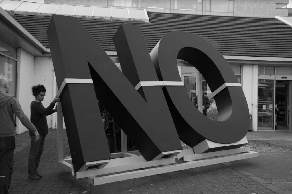 Santiago Sierra, NO, 2009 (Photograph from NO GLOBAL TOUR (Ireland), 2017). Courtesy of the artist and apolitical.