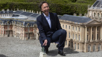 """French journalist, radio host and television presenter Stéphane Bern attends the launch of """"France Miniature"""" in Elancourt in the Yvelines department of France on April 11, 2018. """"France Miniature"""" is a miniature park featuring 117 exact replicas of French landmarks and monuments."""