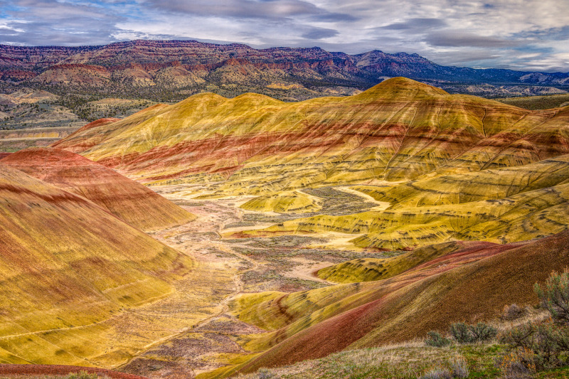 The Painted Hills Unit of the John Day Fossil Beds National Monument in Oregon live up to their name. They are composed of colorful layers of laterite, silstone, mudstone, and volcanic ash.