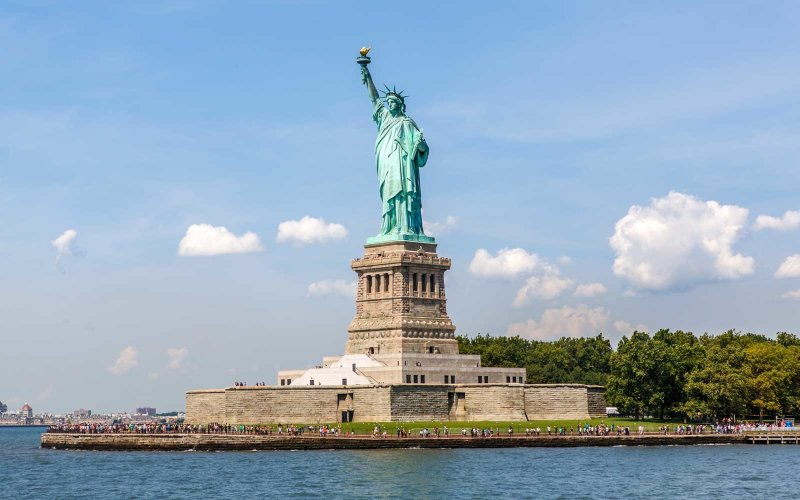 New York, NY, USA - August 11, 2014: View of Statue of Liberty on August 11, 2014 on Liberty Island in New York Harbor, in Manhattan, New York. Statue of Liberty is one of the most recognizable landmark of New York City and one of the symbols of United States of America. The sculpture was a gift from people of France to the United States.
