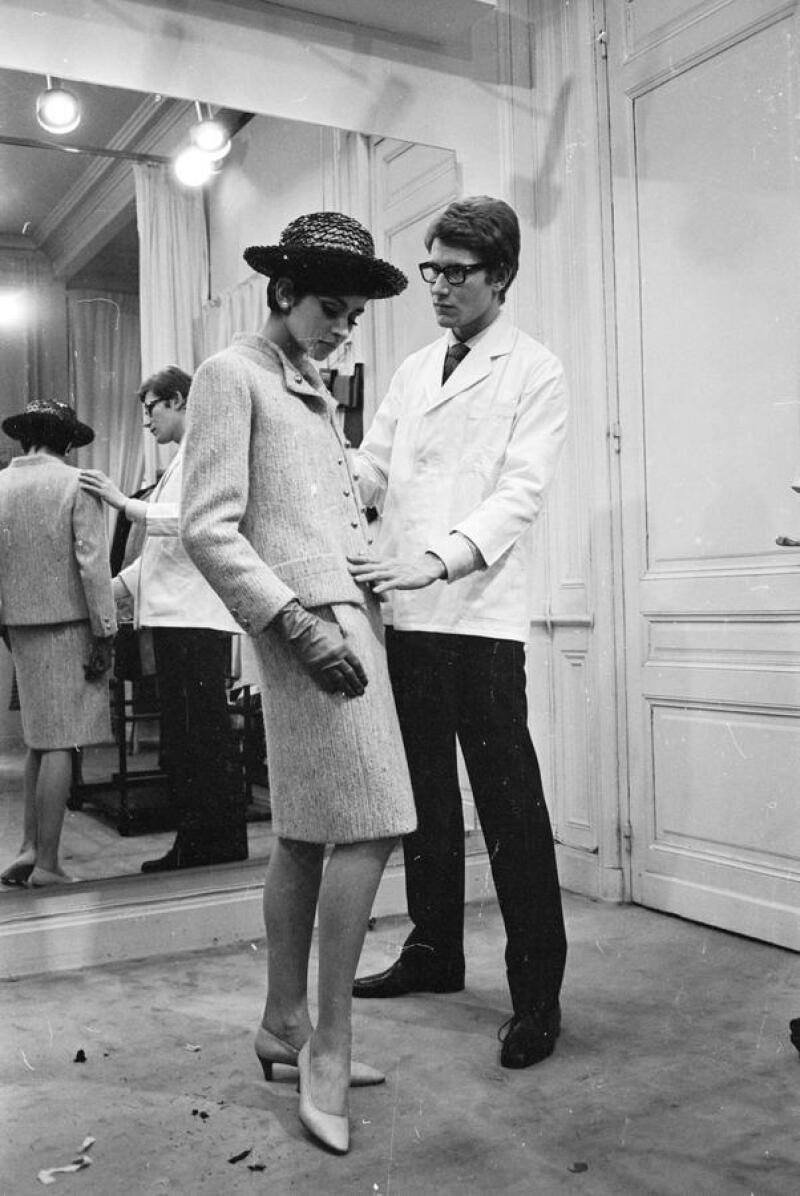 7th April 1965:  Yves Saint-Laurent, ex-wonder boy of Dior, working with a fashion model at his own fashion house in Paris.  (Photo by Reg Lancaster/Express/Getty Images)