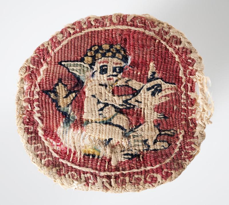 Lin et laineL. 4 ; l. 4 cmÉgypte, trouvé à Akhmim, seconde moitié du 7esiècle -10esiècleBruxelles, Musées royaux d'Art et d'Histoire