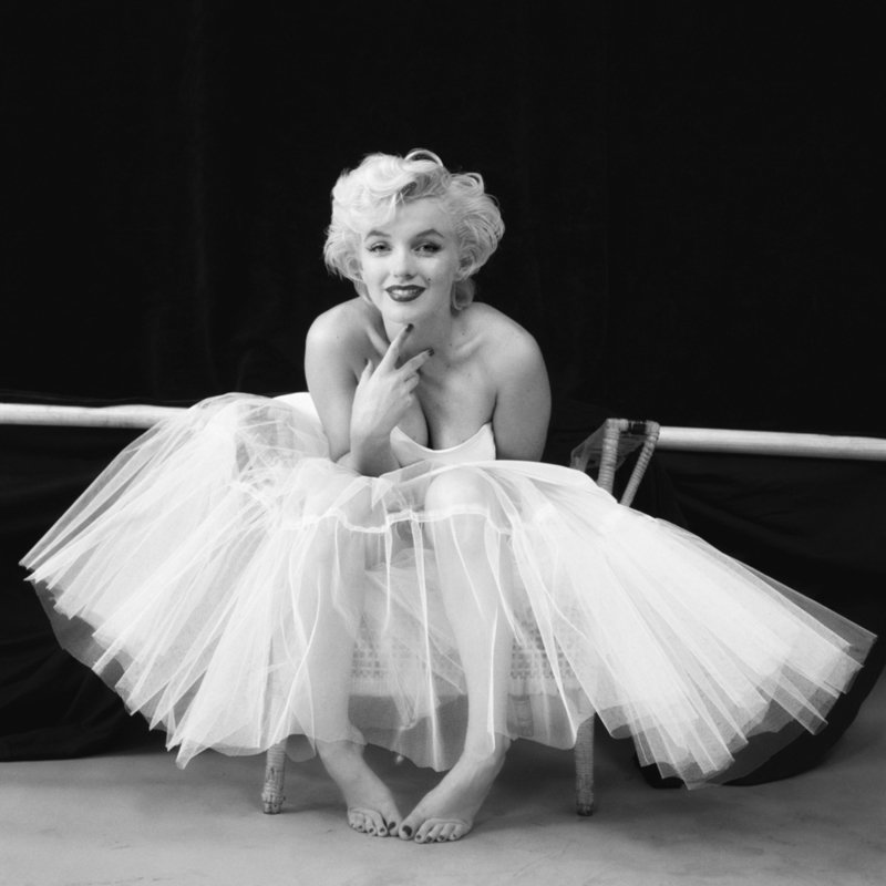 American actress, model and singer Marilyn Monroe poses in a studio in a ballerina dress by fashion designer Anne Klein as part of the 'Ballerina' series, one of Greene and Monroe's most recognisable collaborations, New York, October 1954.