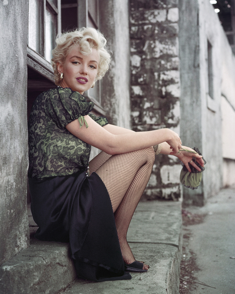 American actress, model, and singer Marilyn Monroe sits on the backlots of 20th Century Fox studios, Los Angeles, CA, April 1956.